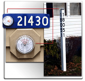 911 locator beacons shown in locations on house number, side paneling of a home, and on a signpost that shows the house number.