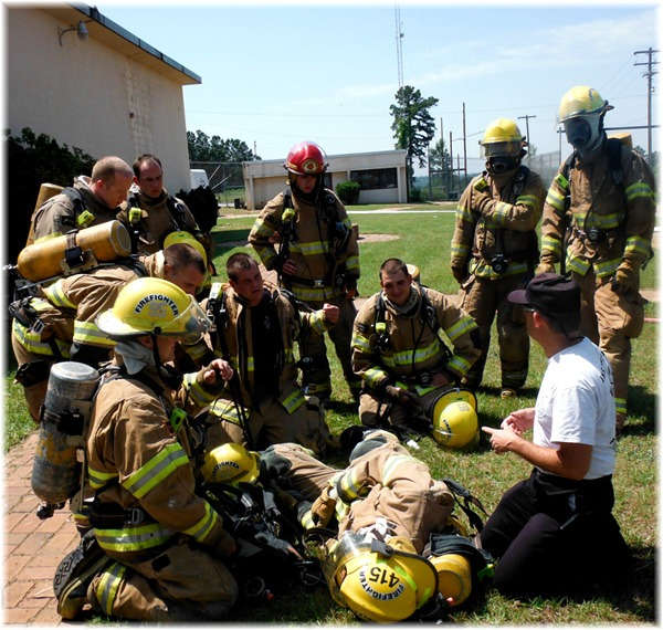 Firefighter Team Circled Around Instructor, Instructor kneeling