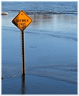 Flash flood, submerged sign